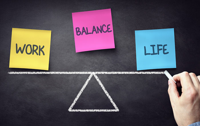 Labels on a balance beam illustrates the concept of work-life balance for lawyers